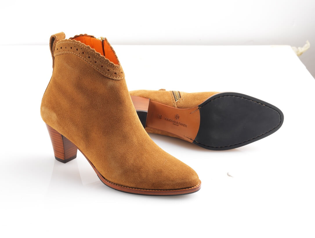 High-heeled light brown ankle boots