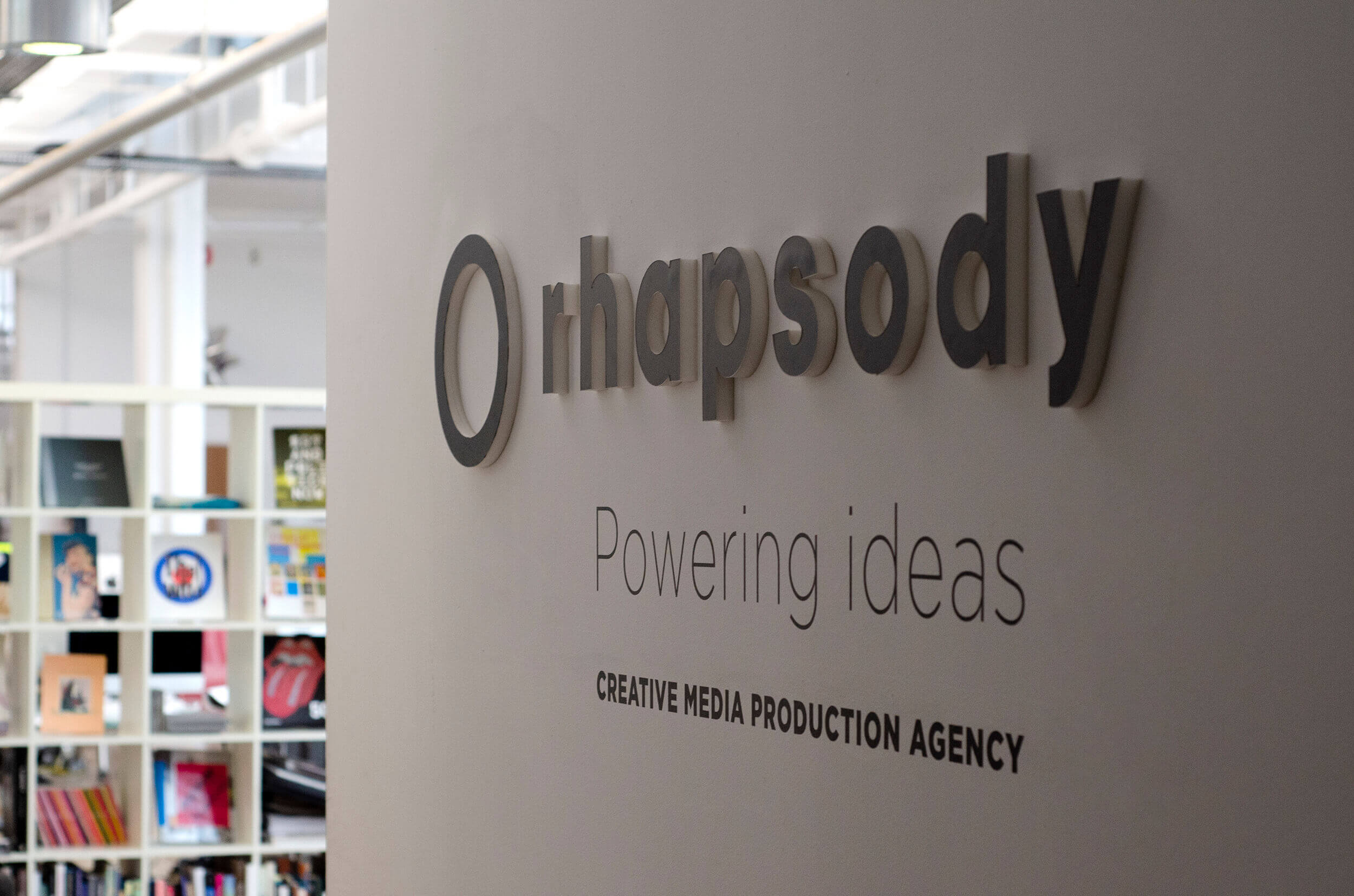 Wall with Rhapsody's logo in one of our offices.